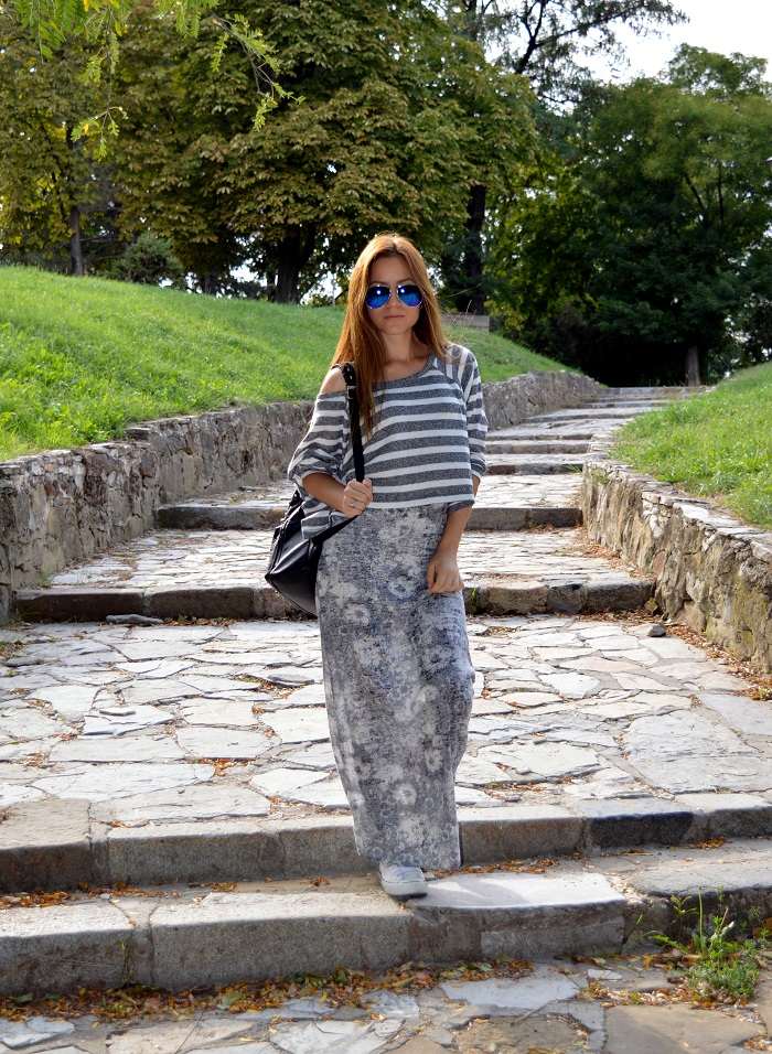 outfit, grey maxi dress with subtle white flowers, striped crop top sweater, blue mirrored aviator sunglasses, black studded backpack