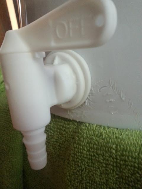 Bottling spigot attached to bottling bucket
