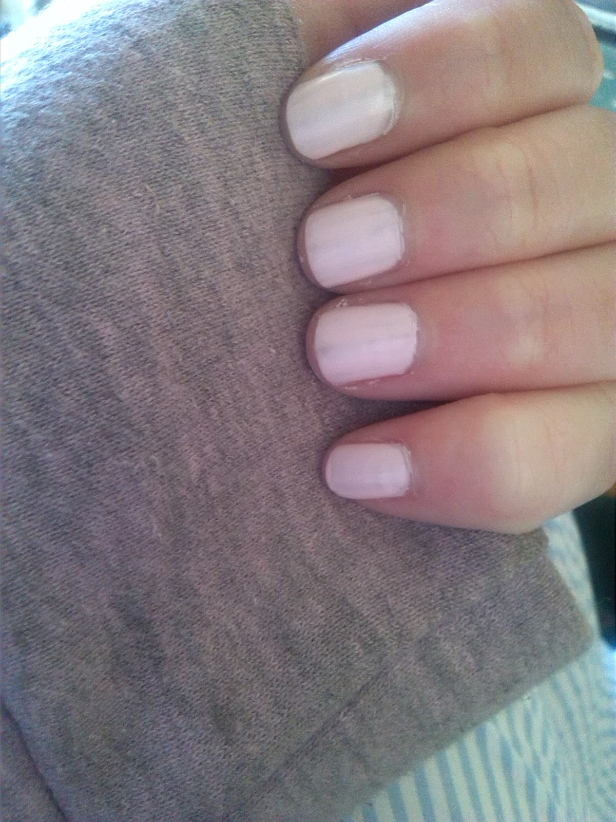 Fingernails painted in Lose Your Lingerie from Rimmel