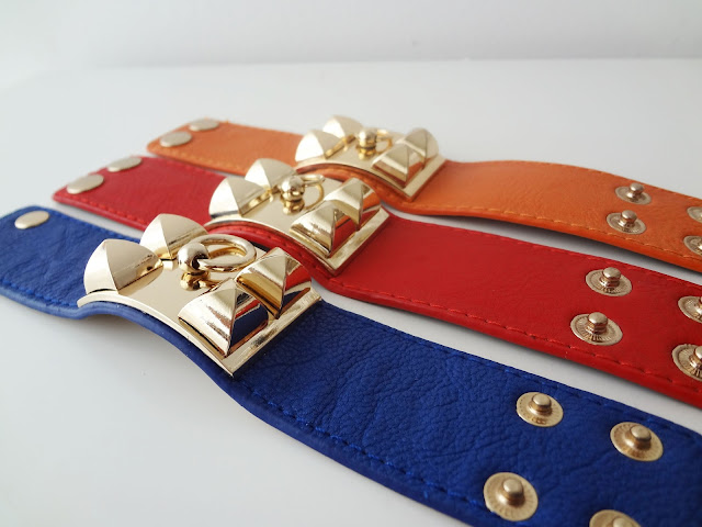 Gold Pyramid Stud Faux Leather Cuff Bracelets close up.
