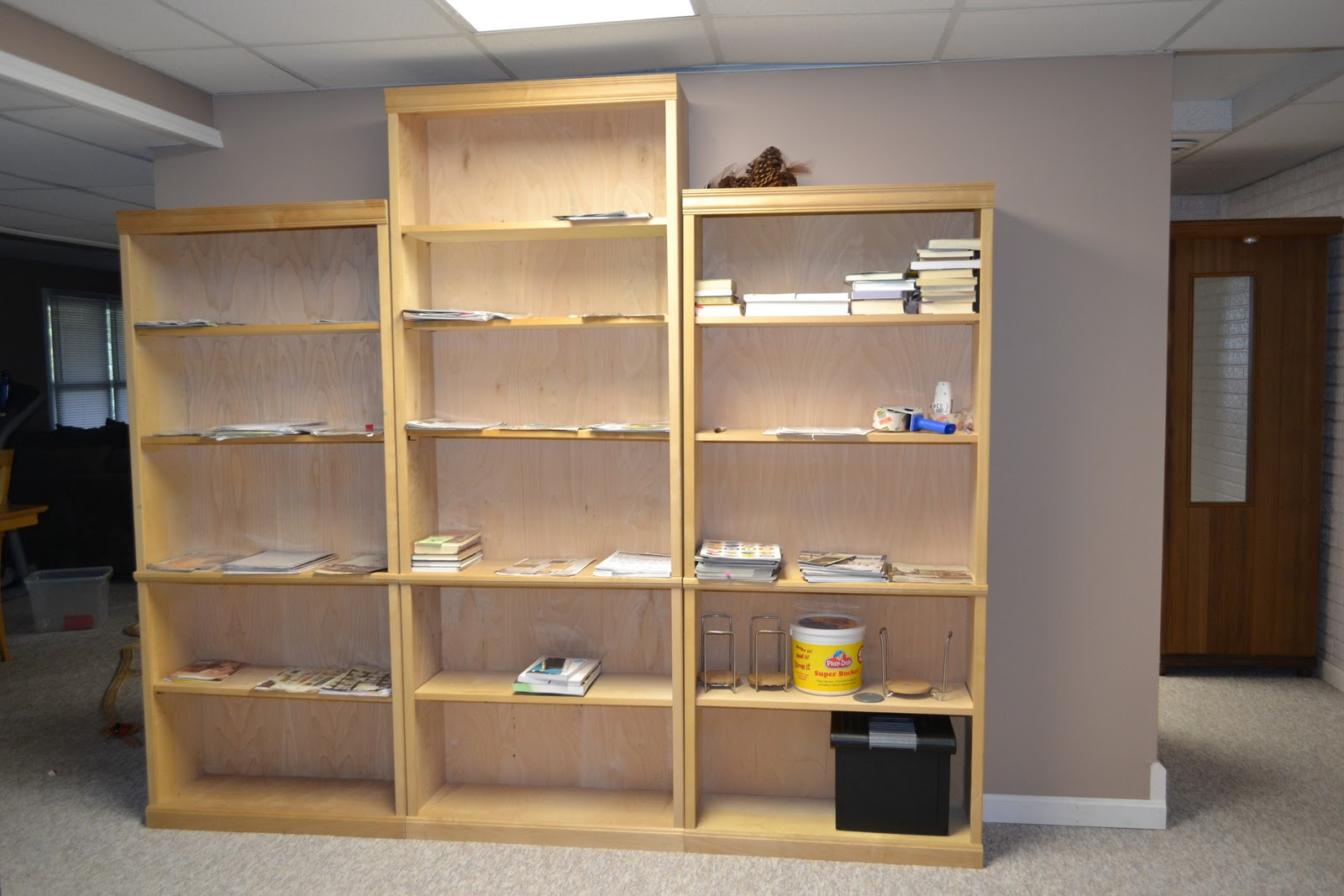 and 7 foot unfinished wood bookshelves, currently used to sort