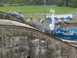 "Twin ""mules"" in town, helping the BUDDY over the lock gate hump at the Panama Canal"