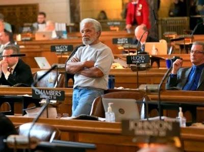 Nebraska state senator Ernie Chambers (center, standing)