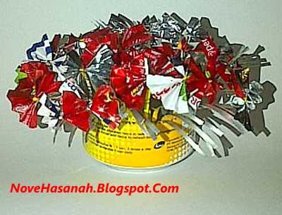 cara membuat bunga pita dari kaleng dan plastik bekas 11
