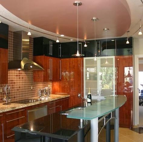 Dise o de peque a cocina moderna con isla de vidrio for Cocinas cuadradas con isla