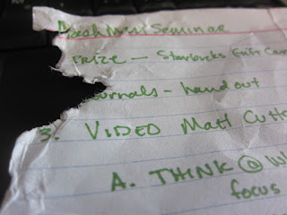 A photo of a chewed on notecard. The corner is missing.