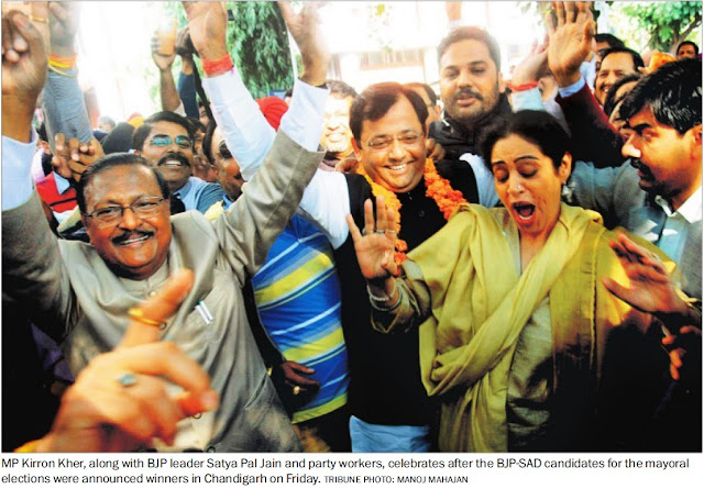 MP Kirron Kher, along with BJP leader Satya Pal Jain and party workers, celebrates after the BJP-SAD candidates for the mayoral elections were announced winners in Chandigarh