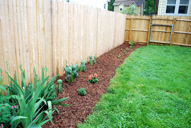In the little yellow house perennial garden along the fence - Landscaping along a fence ...