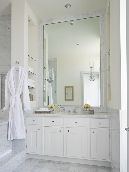 Photo of clean white furniture in the bathroom