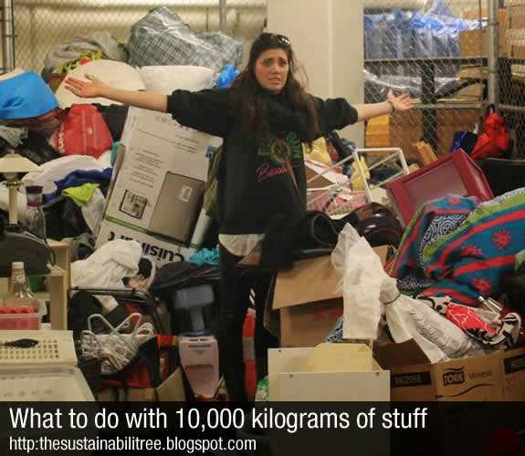 A student stands behind a pile of stuff at uOttawa's Dump & Run
