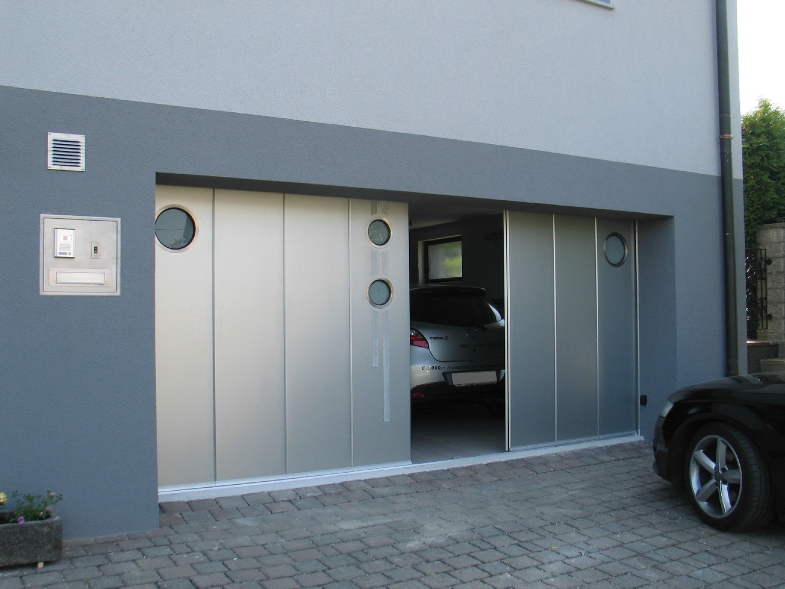 Side sliding doors ryterna garage doors for Garage side entry door
