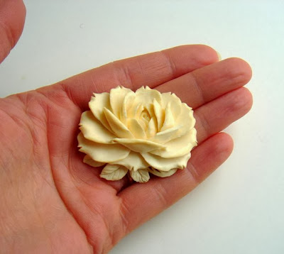 https://www.etsy.com/listing/168609168/vintage-ox-bone-hand-carved-rose-brooch?ref=favs_view_3