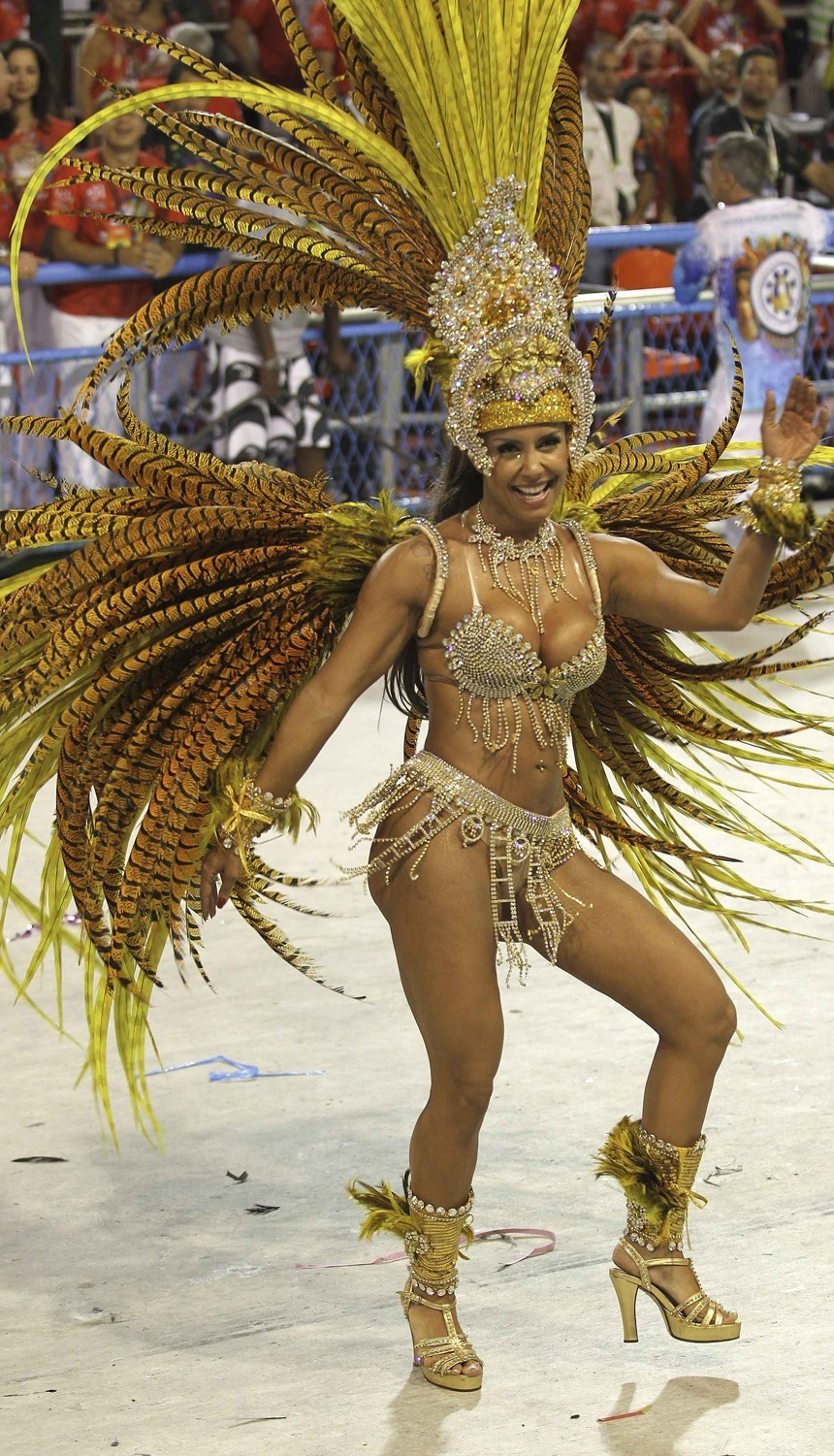 A reveller of the Vila Isabel samba school participates in the annual Carnival parade in Rio de Janeiro's Sambadrome March 6, 2011. REUTERS/Sergio Moraes.