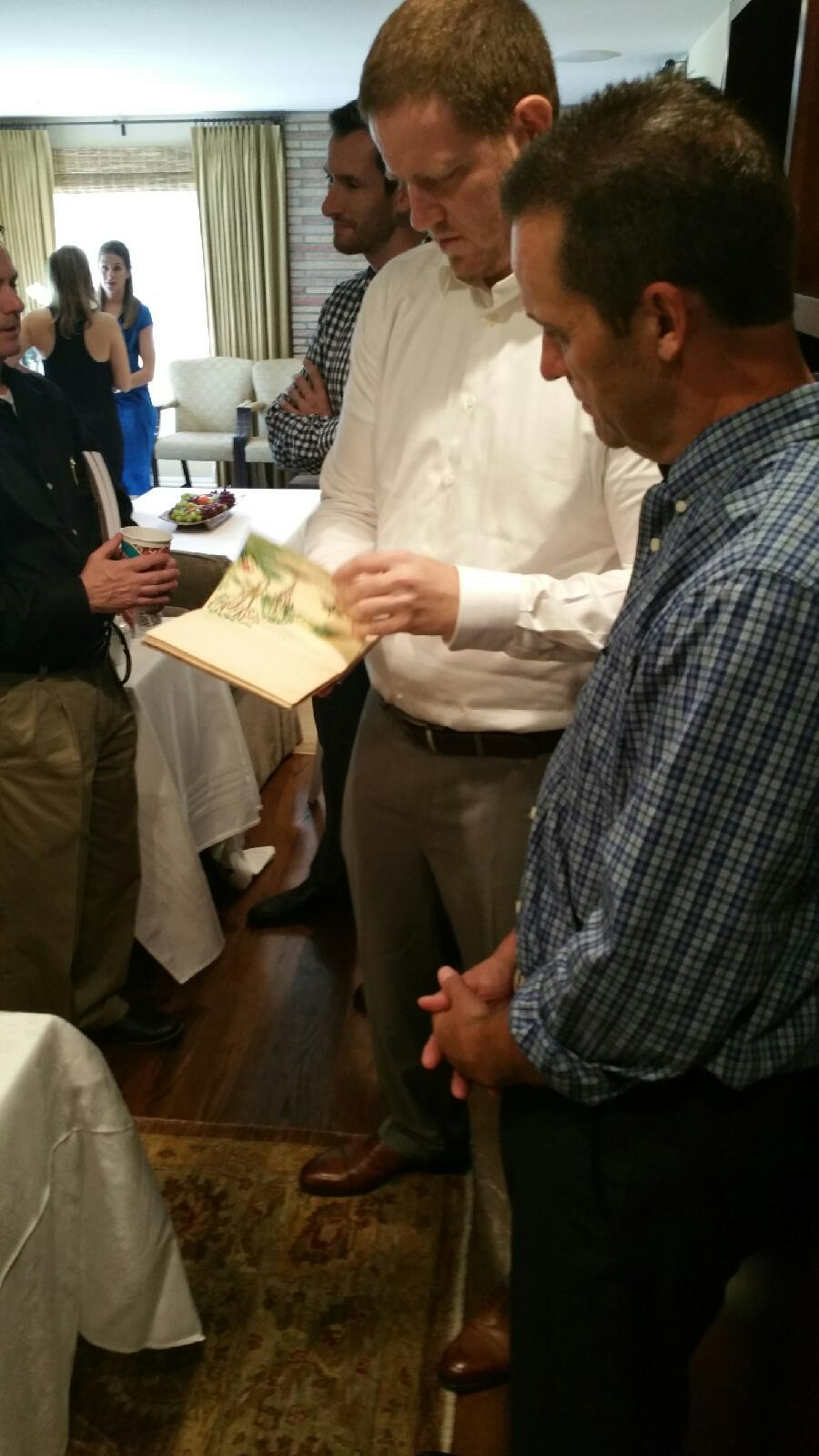 U.S. CongressmanSteve Knight Views The Memory Book