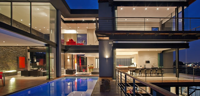 Picture of large modern mansion as seen from the pool area