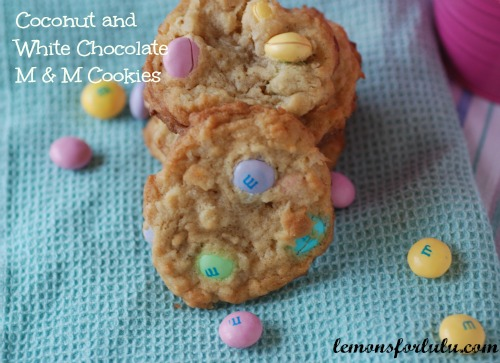 Coconut and White Chocolate M&M Cookies. Easter Candy Dessert Roundup the perfect way to enjoy your pastel Easter Candy from the Easter Egg Hunt. You will love these Easter Candy Dessert Recipes on www.Embellishmints.com