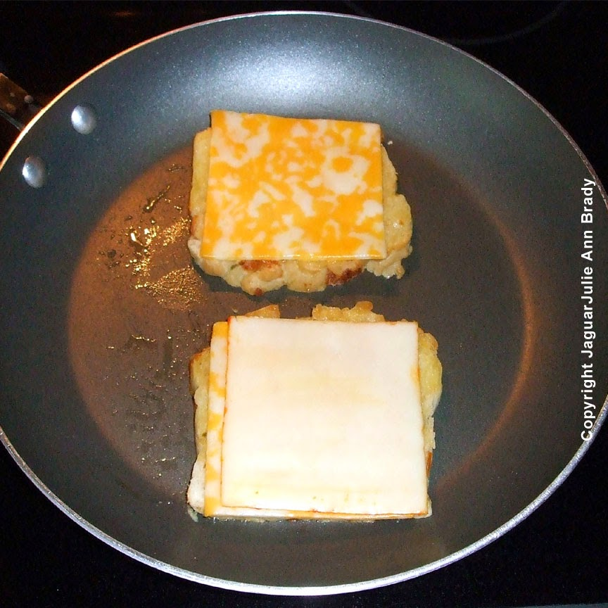 add muenster cheese to one slice of bread for spicy grilled cheese sandwich