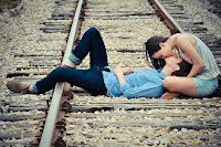 boy and girl love on rail tracks