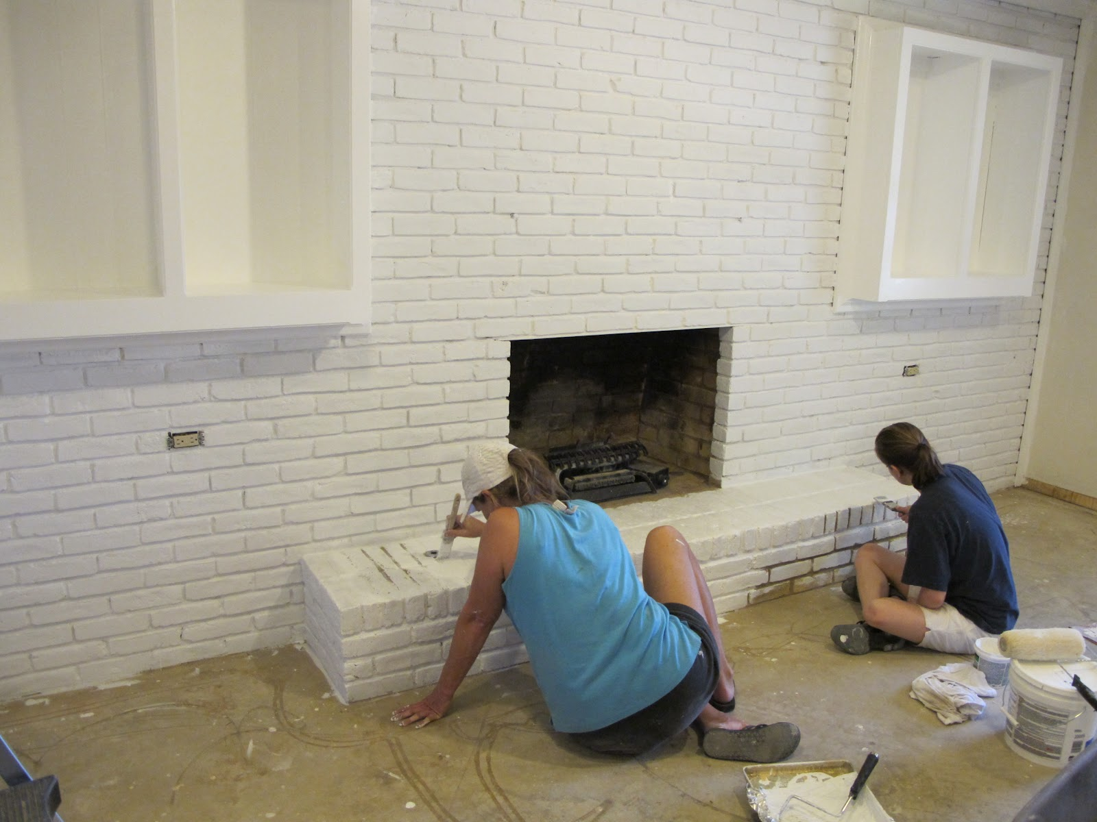 Painted the fireplace brick with a paint spray gun