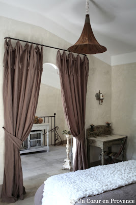 an antique speaker from a gramophone is transformed into a hanging light in the french guest house Un Cœur très Nature