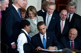 President Obama Signs Affordable Care Act