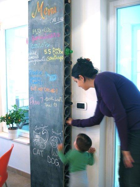 A chalkboard with hidden bottle organizer with PVC pipe :: OrganizingMadeFun.com