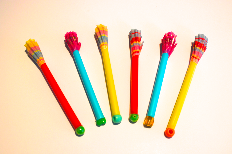 Easy to make homemade darts for kids...straws, cupcake wrappers, beads.