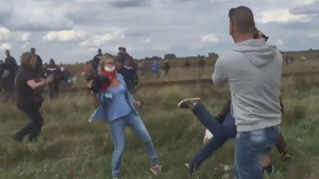 Petra Laszlo, a video journalist of Hungary's N1TV, was fired after she tripped and kicked fleeing Syrian refugees, making them fall.  A video shows that a middle-aged refugee man, who was carrying a child, stumbling down after tripping over the outstretched leg of Petra Laszlo, who was covering the event.