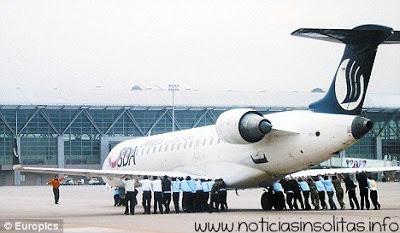 avión empujado pasajeros china