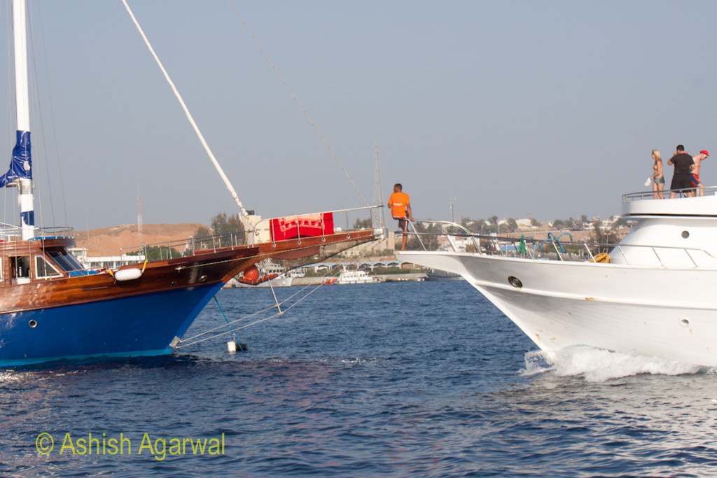 2 ships of different styles crossing each other in the harbor of Sharm el Sheikh