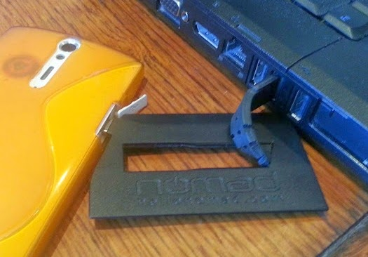 NOMAD ChargeCard USB in use with phone and laptop