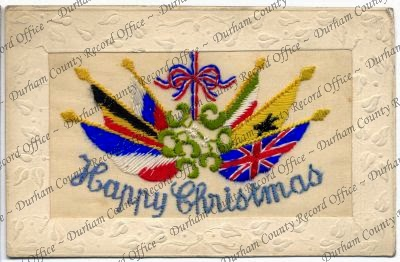 Embroidered postcard showing a design incorporating  the Allied flags and mistletoe (D/DLI 7/652/31)