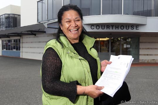 Patricia Emia, Napier, pictured at the Napier Courthouse, Napier District Court, Napier, had court costs of $265 for what began as a $12 parking fine withdrawn from her pay without her knowledge - and then refunded. photograph