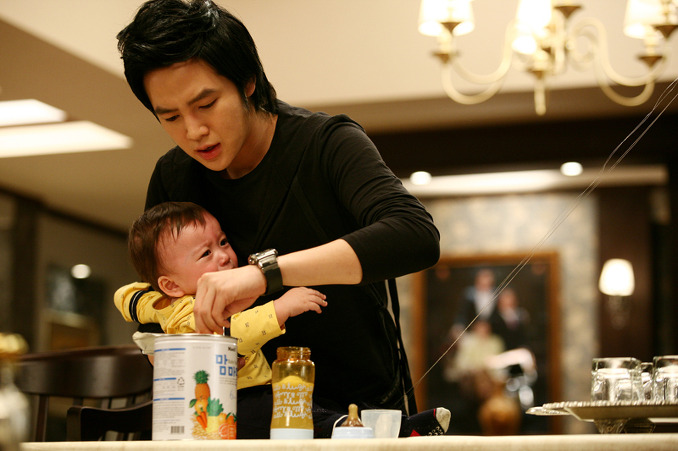 """""""Baby & Me"""" seems to follow this disappointing pattern by turning in another unsatisfactory effort. If you want a taste of a really good Korean comedy featuring a main character always running around with a baby strapped to their back than check out """"Saving My Hubby."""" """"Baby & Me"""" is ."""