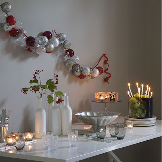 Beautiful Christmas interior decoration with X mas candles, baubles decorated in thread wallpaper