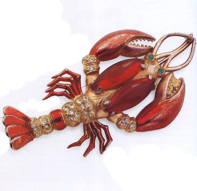 Typical of the whimsical design and bright colouring of pot-metal brooches, this brooch is a sought-after piece. Several variations exist, which were sold through many different outlets and are attributed to many different designers. Made in the United States, it has been attributed to Schiaparelli but is never signed. One variant has claws mounted on springs so that they tremble greatly boosting its value. Whoever made it and whichever company sold it, it remains a fun and collectable piece.