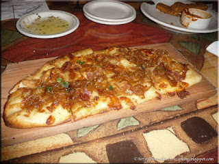 bacaon and caramelized onion flatbread  appetizer