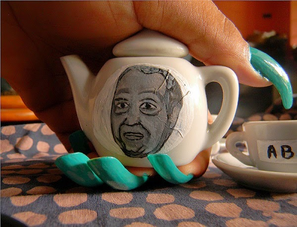 Duvalier portrait on little teapots by Tessa Mars