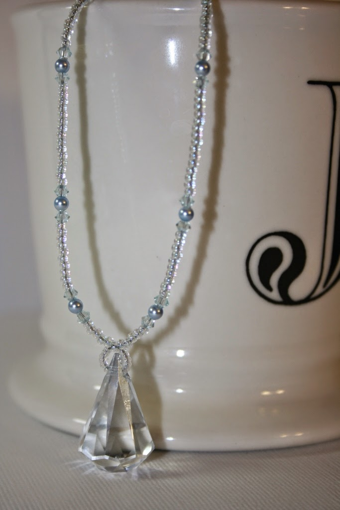 My craft world swarovski crystal blue shade raindrop pendant i love this raindrop shaped pendant and the light blue crystal is very elegant below is a closer look of this pendant aloadofball Gallery
