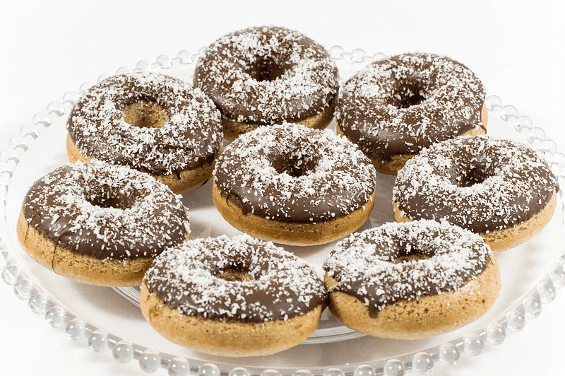 Vegan cocos donuts with chocolate on a plate