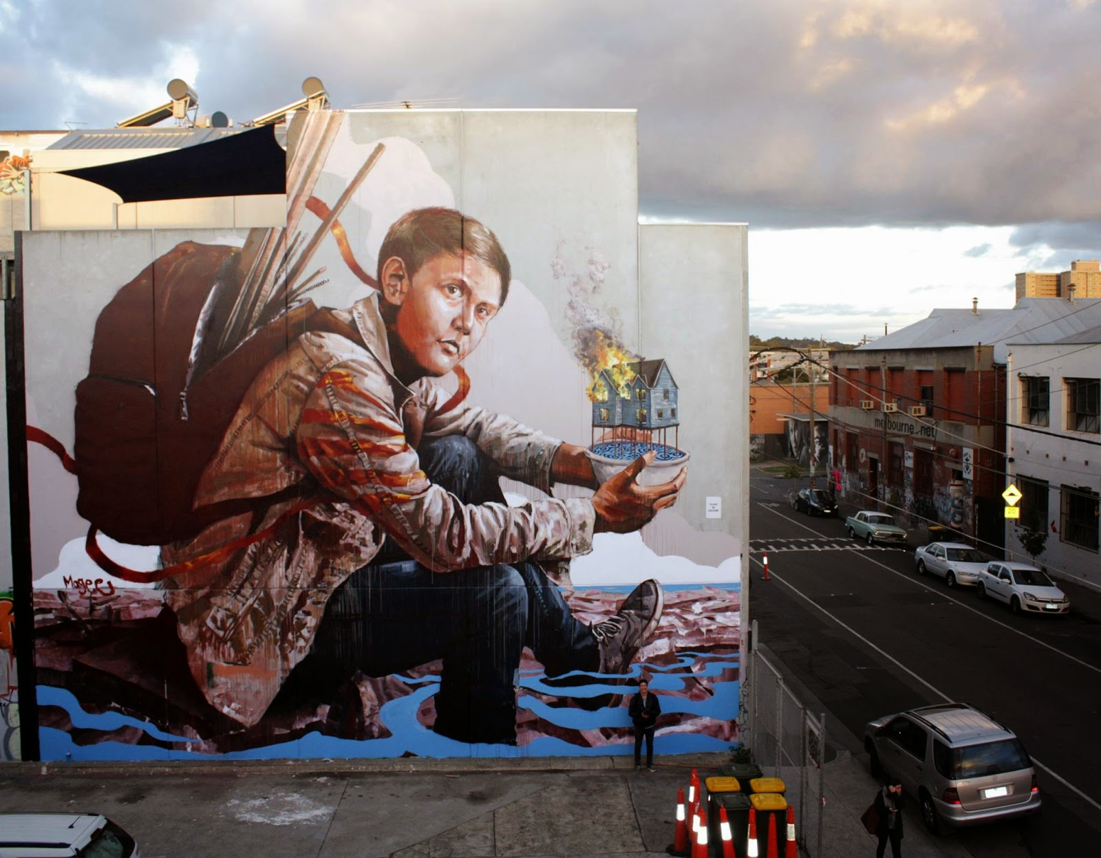 Fintan Magee is currently in Australia where he just wrapped up yet another gigantic mural somewhere in Collingwood, Melbourne.