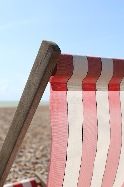 worthing deck chairs beach pier