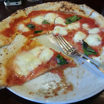 a half eaten artisan pizza