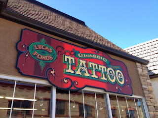 chris dobell traditional sign painted traditional signage for luke fords classic tattoo in canada north america