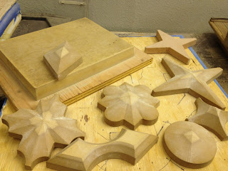 Wooden forms are carved out to the exact specification of the plastic mold that will form the tile.