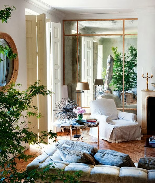 eclectic white living room gold accents oversized mirror mirrored wall