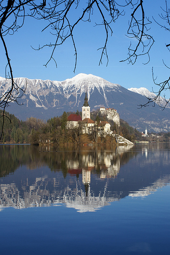 church mountains lake europe