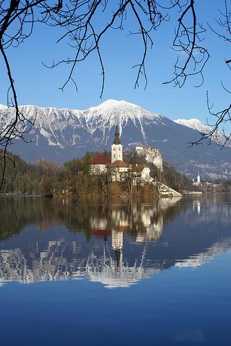 church mountains lake europe