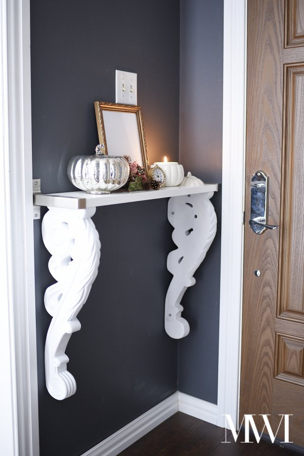 This foyer entry table provides an inviting first impression to guests when they enter the door.