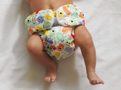 Handmade by Joanne Rich, this cloth diaper features Velcro tab pockets.